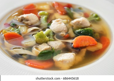 Plate with delicious turkey soup, close up