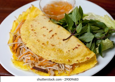 A plate of delicious Vietnamese pancake with loads of Vietnamese favourite herb--the basil leaves.