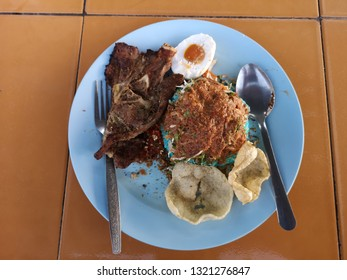 A plate of delicous nasi kerabu with daging bakar.