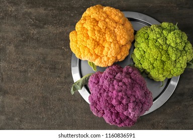Plate with different cauliflower cabbage on grey table