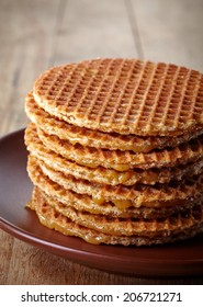 Plate of dutch waffles on wooden background