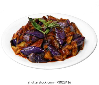 Plate of festive purple eggplant and tofu with sauce