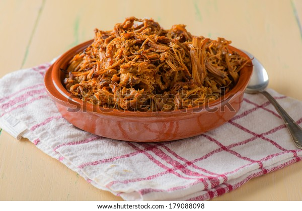 Plate filled with pulled pork on a round dish