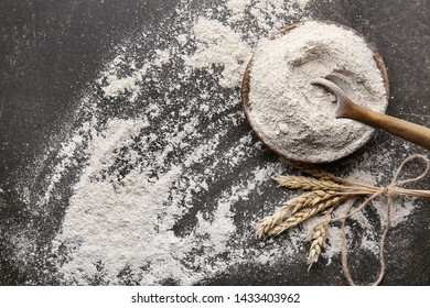Plate with flour on grey background
