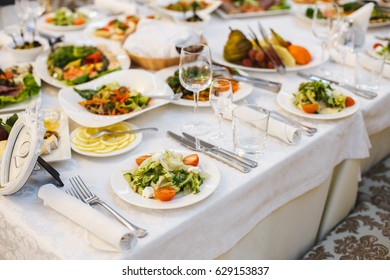 Plate with food on the table, Snacks at the banquet, Wedding banquet, Table setting, Dinner food, gala dinner, cheese plate, Wedding dinner