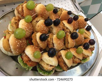 Plate of food snacks.Buffet table.Catering.Chicken mini burgers.