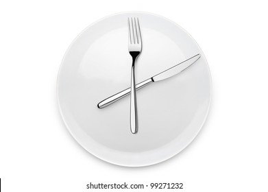 plate with fork and knife at twelve o'clock position, on white background