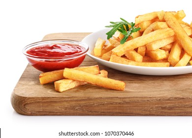 Plate with french fries, ketchup and rucola on a wooden board. With clipping path.