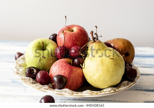 Plate with fresh fruits
