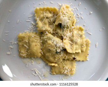 plate of fresh homemade Italian ravioli with parmesan cheese