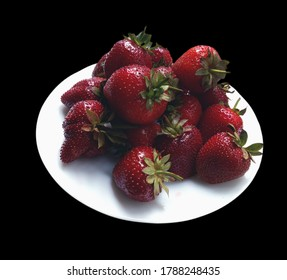 Plate with fresh strawberries, close up, isolation on black. Smartphone photo.