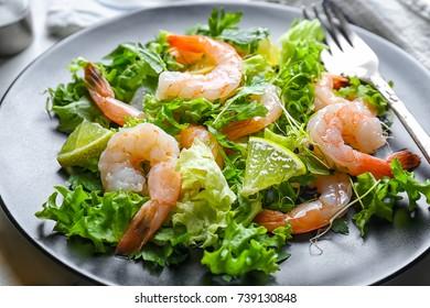 Plate with fresh tasty shrimp salad, closeup