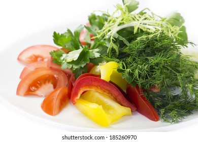 plate with fresh vegetables on a white background