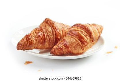 plate of freshly baked croissants isolated on white background