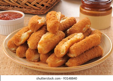 A plate of fried cheese mozzarella cheese sticks