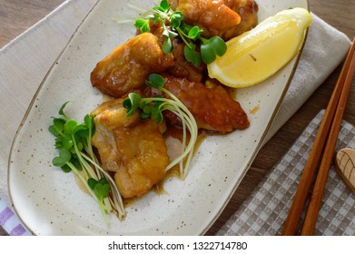 a plate of fried chicken with butter and Japanese soy sauce
