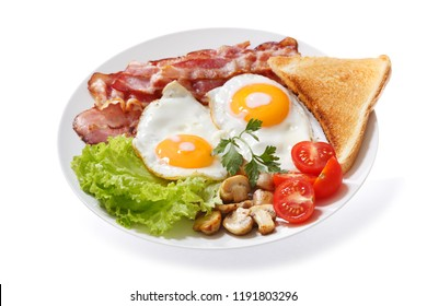 plate of fried eggs, bacon, mushrooms, salad and toast isolated on white background