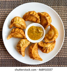 Plate of fried Nepalese momos and its achar (sauce)