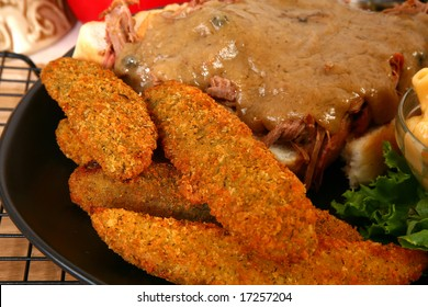 Plate of fried pickles with open roast beef sandwich.