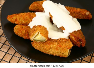 Plate of fried pickles and ranch dressing.