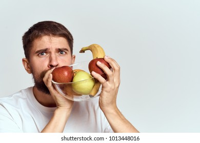 plate of fruit, a man on a light background
