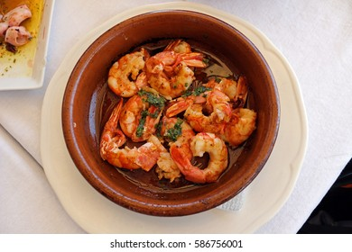 A plate of garlic prawns from a local restaurant called Casa Isabel in Valencia, Spain