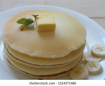 a plate of gluten free pancake with butter