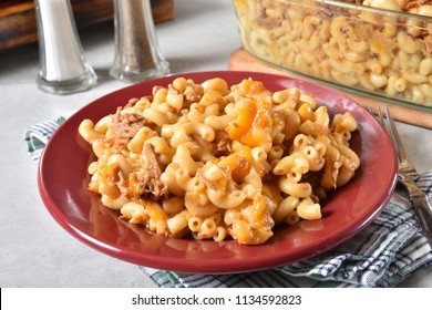 Plate of gourmet macaroni and cheese with barbecued beef