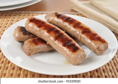 A plate of grilled bratwurst