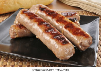 A plate of grilled bratwurst or sausages