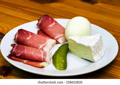Plate with ham cheese egg glass beer