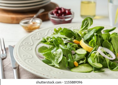 Plate with healthy vegetable salad on table, closeup