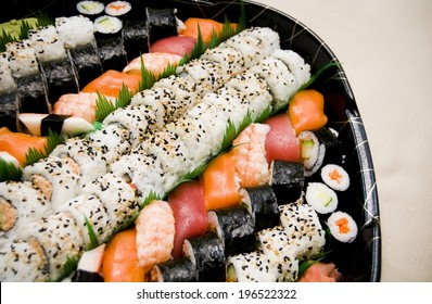 A plate holding different types of sushi pieces.