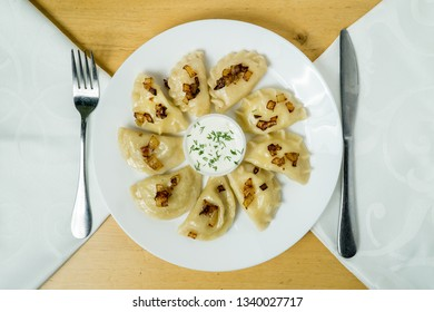 Plate of homemade assorted Perogies, Ukrainian traditional dish