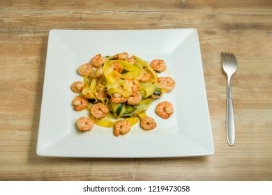 Plate with homemade shrimp scampi zucchini noodles.