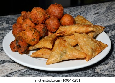 A plate of Indian snacks - samoosas and chilli bites (bhajas)
