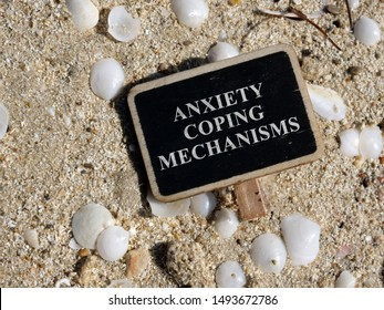 Plate with the inscription Anxiety coping mechanisms lies on the beach. - Shutterstock ID 1493672786