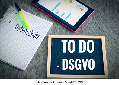 Plate with the inscription To Do DSGVO (Datenschutzgrundverordnung) and Datenschutz  in English GDPR and Data Protection with a tablet and block for the introduction of the DSGVO in the EU