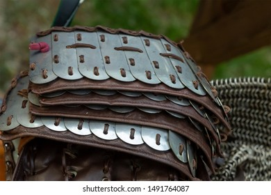 plate iron plate on a leather base, shoulder pads the upper part, lies in a stack closeup