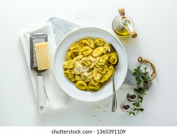 plate of italian ravioli with parmesan cheese on the plate of italian cooked ravioli tortellini with parmesan cheese on the table. healthy Mediterranean foodtable. healthy Mediterranean food