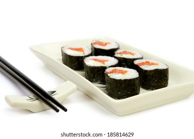 The plate of japanese rolls on white background