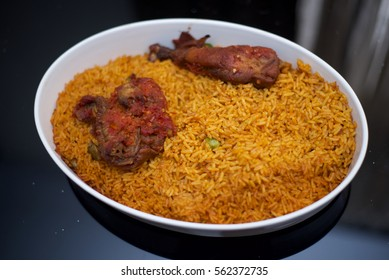 A plate of jollof rice and chicken