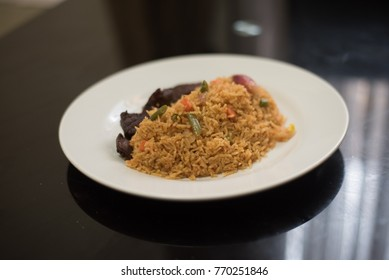 A plate of jollof rice and fried beef