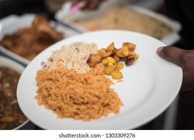 A plate of jollof rice, fried plantain and oriental fried rice