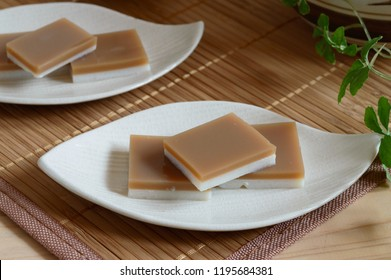 a plate of kanten jelly. Kanten  or agar-agar is a jelly-like substance, obtained from red algae. It is one of the most common ingredients in Japanese cuisine.