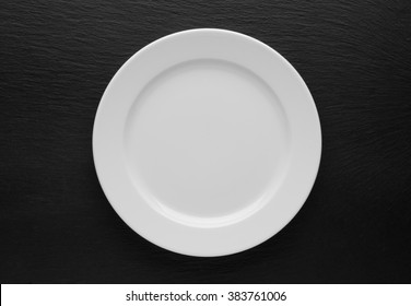 plate, knife and fork on table background