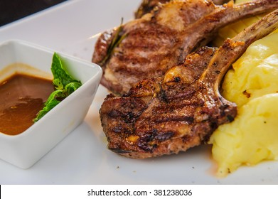 Plate of lamb chops with mashed potatoes.