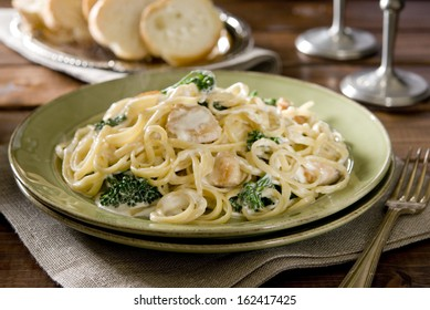 Plate of linguine with chicken, broccoli and Alfredo sauce.