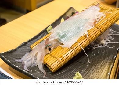 plate of live ika squid sashimi taken in a restaurant in fukuoka, japan