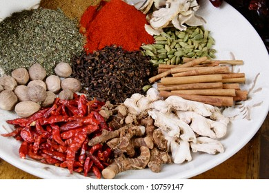A plate loaded with colorful spices